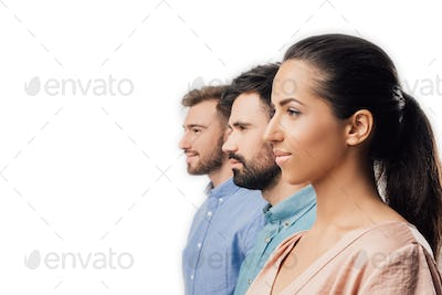 side view of young businesswoman and businessmen standing in line isolated on white