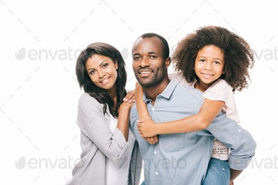 beautiful happy african american family with one child smiling at camera isolated on white