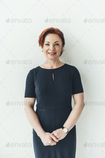 smiling happy mature woman holding hands on white background