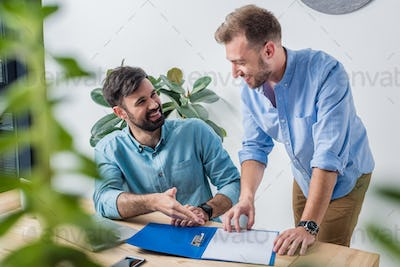 portrait of businessmen discussing new project at workplace in office