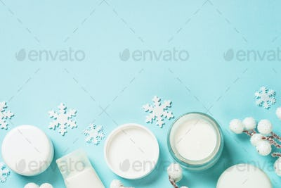 Winter cream for skin on blue top view