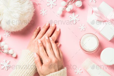 Woman using winter cream for hands