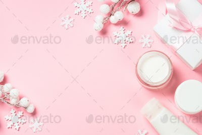 Winter cream for skin on pink top view