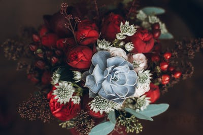 beautiful wedding bouquet with red roses and succulents