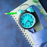 Alarm clock and businessman's accessories