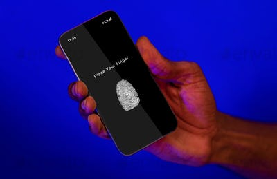Black man holding phone with fingerprint scanning app