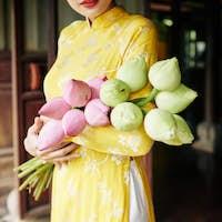 Woman holding fresh lotus flowers