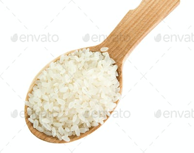 grain in wooden spoon isolated on white