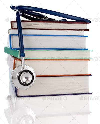 books and stethoscope isolated on white