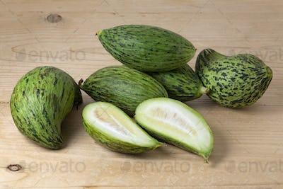 Fresh whole and halved Kelek fruit