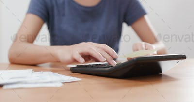 Woman use of calculator for daily expense