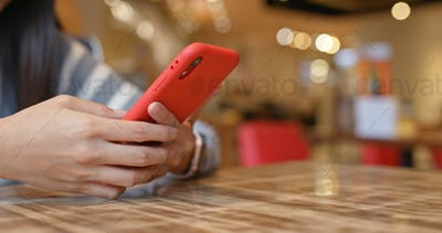 Woman use of mobile phone in restaurant