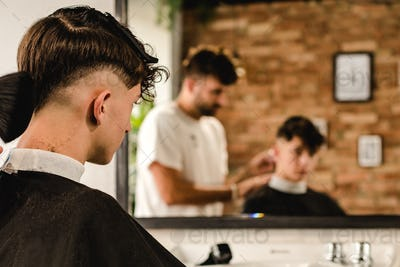 Men Hair Salon. Barber Doing Haircut In Barbershop. Young Male Client And Hairdresser.