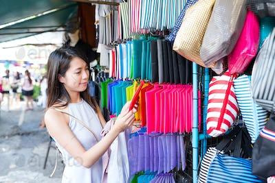 Woman shopping in market in Bangkok city
