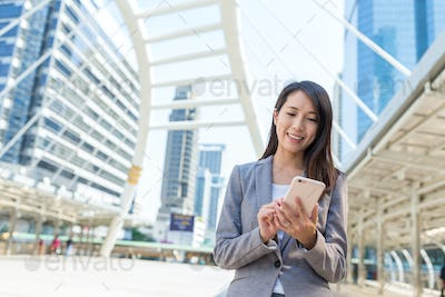 Business woman use of mobile phone in bangkok city