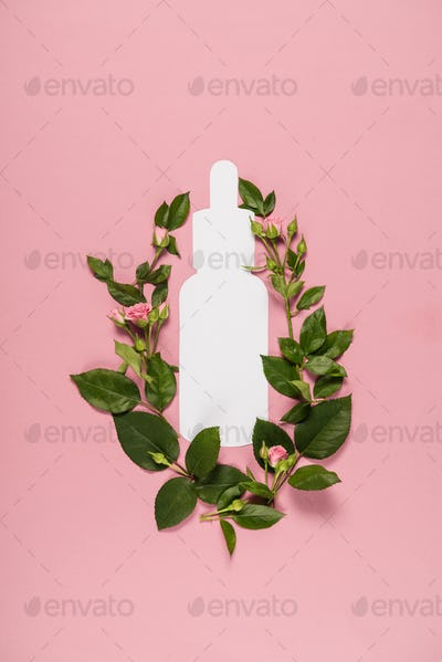 cut out nose drops with fresh leaves, organic cosmetics, isolated on pink