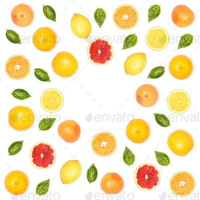 composition of citrus fruits and basil leaves isolated on white