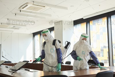 Two People Disinfecting Office
