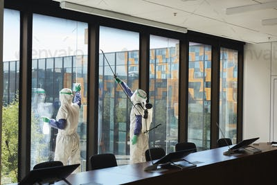 Wide Angle of Workers Disinfecting Windows in Office