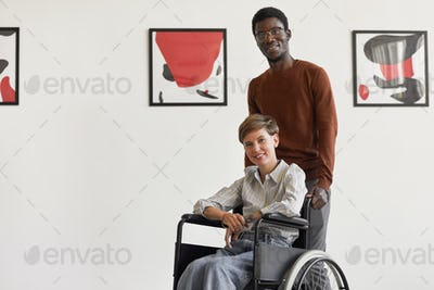 Disabled Woman Visiting Art Museum with Caregiver