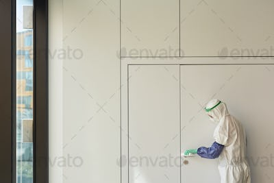 Graphic Background of Sanitation Worker Disinfecting Office