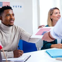 People voting in polling place, usa elections and coronavirus