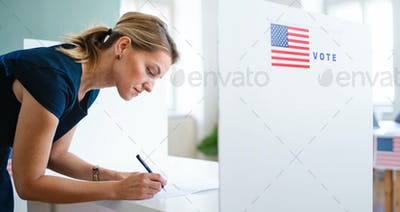 Portrait of woman voter in polling place, usa elections concept