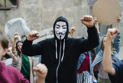 Group of people activists with face mask protesting on streets, strike and demonstration concept