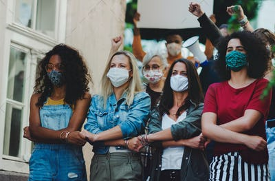 Group of people activists protesting on streets, women march, demonstration and coronavirus concept