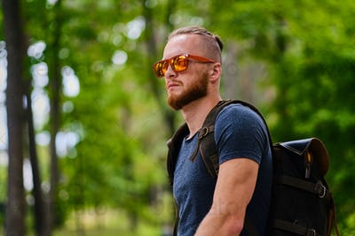Portrait of redhead male in sunglasses.