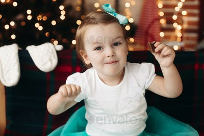 Cheerful little girl looking at camera, posing
