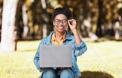 Black Student Woman Using Laptop Learning Online Sitting In Park