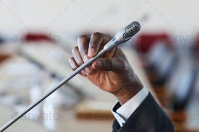 Businessman speaking in microphone