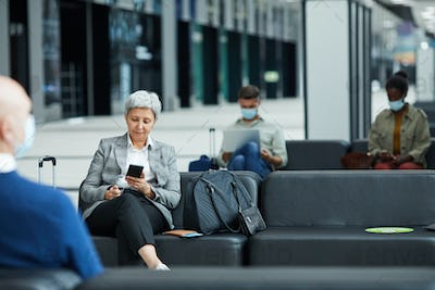 Woman sitting at the airport