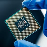 Semiconductor microchip in gloved hand