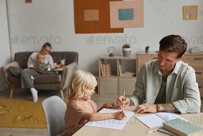 Parents teaching the children