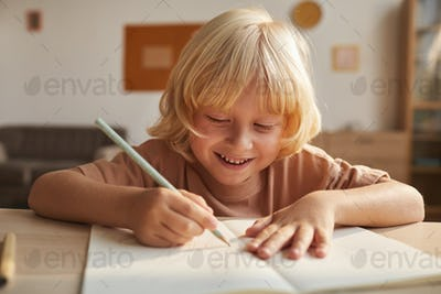 Child writing the report