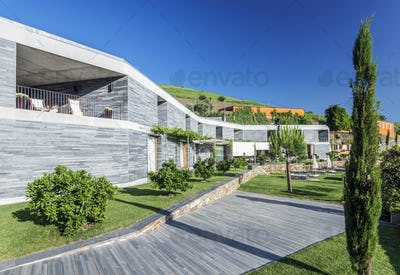 Modern hotel and wooden walkway