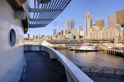 Ship deck in Seattle harbor overlooking cityscape, Washington, United States