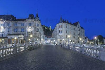 Pedestrian bridge and buildings illuminated at night, Ljubljana, Central Slovenia, Slovenia
