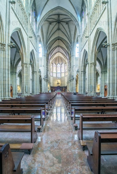 Pews and arches in ornate church
