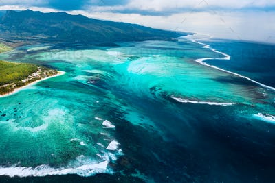 The view from the bird's eye view of the coral reef near the mountain Le Morne Brabant, a