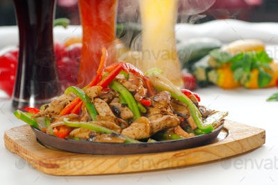 original fajita sizzling hot  on iron plate
