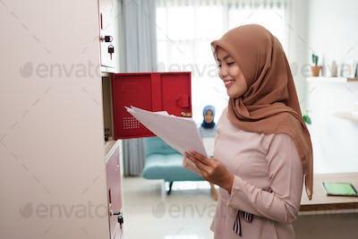 a portrait of a beautiful Muslim woman preparing a bill paper
