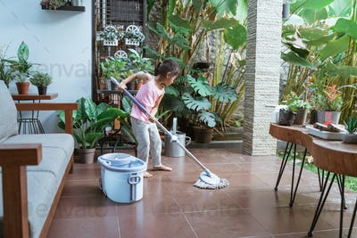 Beautiful Little Girl Doing Cleaning Chores with Mop and Bucket