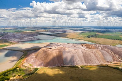 Mountains of products for the production of potash salt and artificial reservoirs.Salt mountains