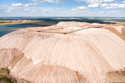 Mountains of products for the production of potash salt.Salt mountains near the city of Soligorsk