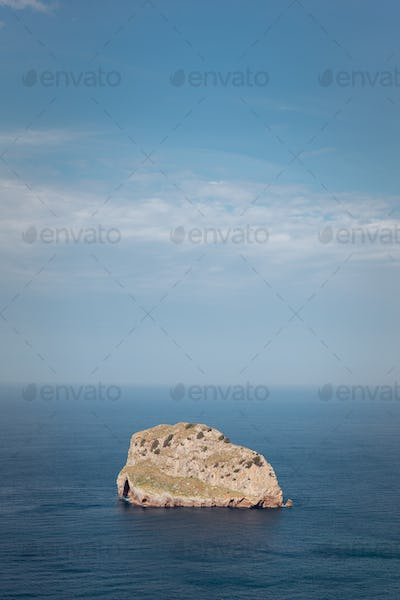 Lone giant rock in the middle of the ocean