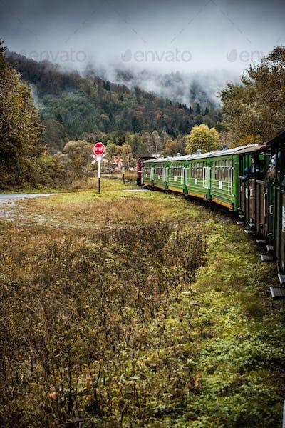 Retro Train Journey Trough Bieszczady Mountains in Poland. Autum Season. Moody and Toned Image