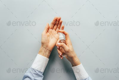 Sanitary treatment of hands with a spray disinfector. Self-isolation and hygiene in the epidemic